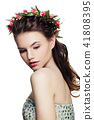 Young Woman Fashion Model with Braids Hairstyle and Makeup Isola 41808395