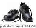 Black women's sports shoe on a white background. 41814556