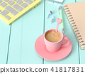 Coffee milk in pink cup on work desk 41817831