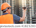 Asian engineer holding drone at construction site 41823283