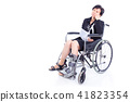 woman with broken arm and leg on wheelchair 41823354