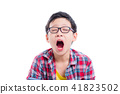 Young asian boy yawning over white background 41823502