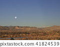 The full moon sinking in the Rocky Mountains 41824539