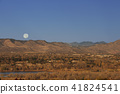 The full moon sinking in the Rocky Mountains 41824541