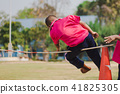 Students Grade 3  take exams High jump. 41825305