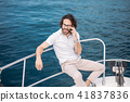 Young bearded man on a luxury yacht with a magnificent view of the sea. 41837836