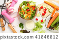 Mixed vegetables salad and fitness equipments 41846812