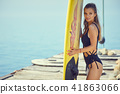 Surfing woman 41863066