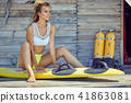 Surfing girl posing in the beach with surfboard 41863081