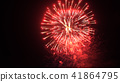 Beautiful red fireworks explosion in the night sky 41864795