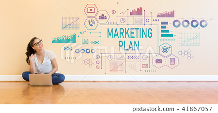 Marketing plan with young woman using a laptop computer  41867057