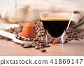 A cup of coffee and capsule coffee close up 41869147