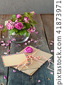 bouquet of wilting tea roses, pile of old letters 41873971