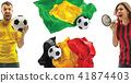 The collage about emotions of football fans of Brazil and Belgium teems and flags isolated on white 41874403