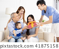 happy family celebrating and giving gift to father 41875158
