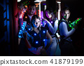 Young people with laser guns on lasertag arena 41879199