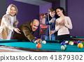 People playing billiard 41879302
