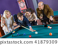 Relaxed people playing billiard and darts as hanging out 41879309