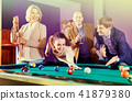 Group of cheerful pretty positive friends playing billiards 41879380