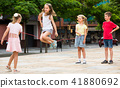 children with jumping rope at playground. 41880692