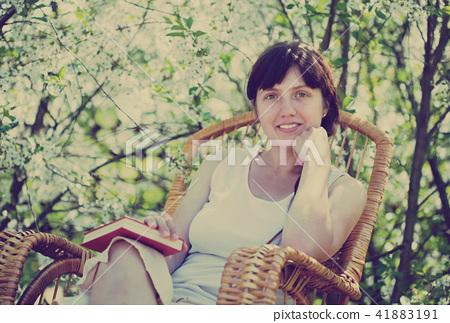 girl in flowering garden 41883191