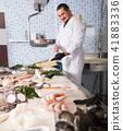 man, fish, glove 41883336