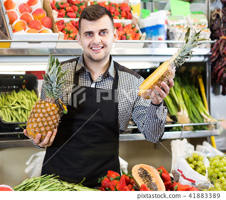 shopping assistant demonstrating assortment of grocery shop 41883389