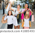 Portrait of family of four people happily shopping together in the city 41885493