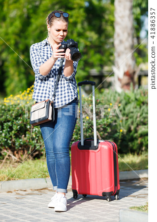 Adult woman traveler making photo of sights 41886357
