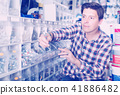 Smiling male in hardware shop buying goods 41886482