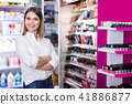 Portrait of attractive confident salesgirl in cosmetics shop 41886877