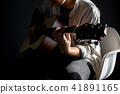 musician playing the guitar 41891165