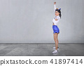 Smiling asian cheerleader in white and blue suit 41897414