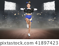 Young asian cheerleader in action with pom poms 41897423