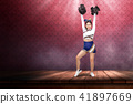 Smiling asian cheerleader with pom poms 41897669