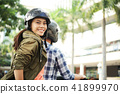 Young woman enjoyng bike ride 41899970