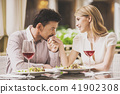 Couple Dating in Restaurant and Drinking Red Wine. 41902308
