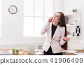 Business woman talking on phone at window 41906499