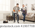 Young couple cleaning home, having fun 41907708