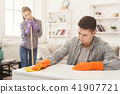 Young couple cleaning home together 41907721