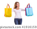 Beautiful caucasian woman wear white shirt and jeans and holding colorful shopping bags. Studio shot isolated on white background 41916159