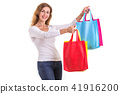 Beautiful caucasian woman wear white shirt and jeans and holding colorful shopping bags. Studio shot isolated on white 41916200