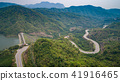 Asphalt road on the hill in Phetchabun province, Thailand. Aerial view from flying drone. 41916465