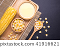 Fresh yellow sweet corn on the cob and corn juice 41916621