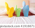 Foots of family with color sock on the bed 41916671