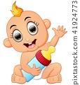 Happy baby cartoon holding milk bottle 41924773