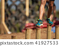 Mud race runners,during extreme obstacle races 41927533