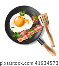 Vector fried eggs with bacon strips and parsley 41934573