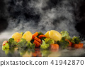 Steamed vegetables on tray. 41942870