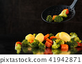 Steamed vegetables on tray. 41942871